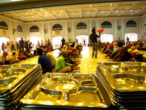 Pilgrims and visitors wait for their portions.