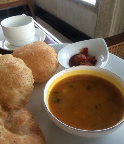 Poori or Puri  Unleavened Bread. As puffy as it gets! With potato masala.