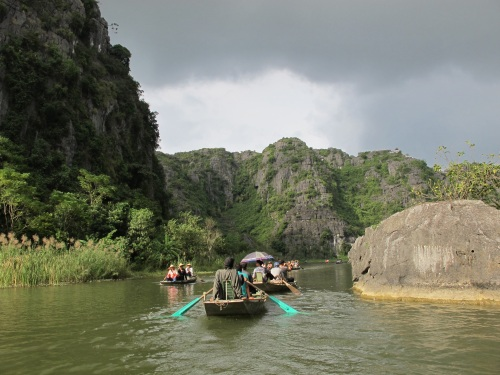 The Sampan Ride along the river hemmed by rice paddies, dotted by limestone rock formations.