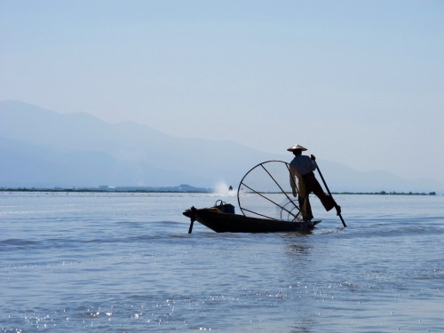 Traditional way of fishing uses one leg with hands free to catch fish using a basket net.